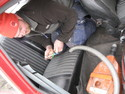 Micke vacuum-cleans the car for the inspection.